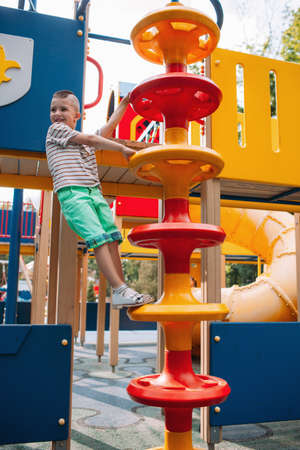 Little fidget boy get fun in the park. Activity leisure. Family lifestyle.