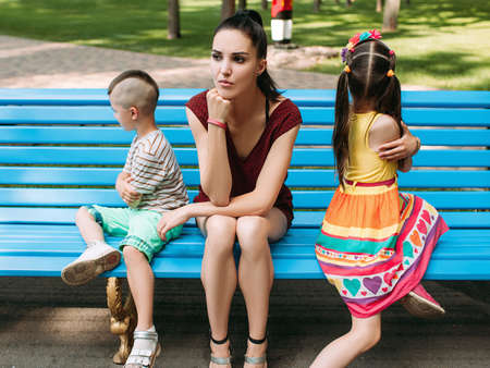 Childish offenses family quarrel park concept. Motherhood problems and disappointment.