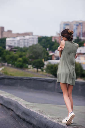 Roof walk pretty girl alone concept. Lack of warmth and care Stock Photo