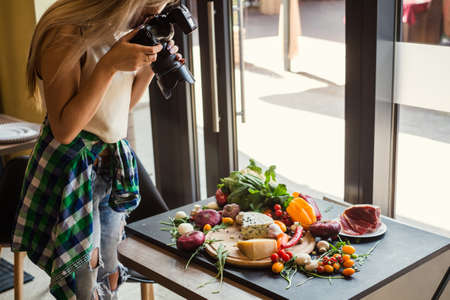 Food photographer at work. Creativity art hobby leisure concept Banque d'images