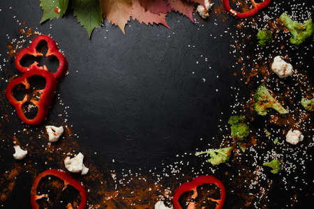 vegetables and spices. food ingredients on dark background. copy space concept. kitchen creativity