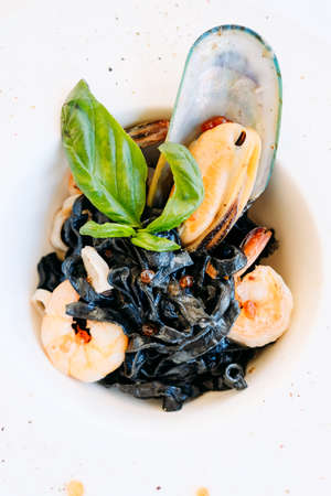 gourmet breakfast meal black pasta seafood concept. luxury food. delicacy recipe.