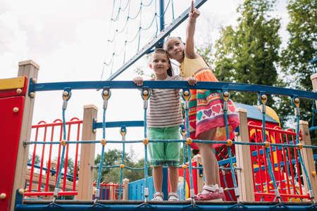 Little fidget children get fun in the park. Family lifestyle. Activity leisure.