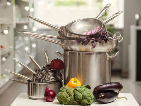 Stack of professional kitchen pans. Restaurant cooking untensils. Healthy food and proper nutrition concept Stock Photo - 92881898