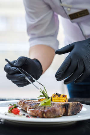 Food perfectionist. Styling meal with precision concentration and excellence. Restaurant serving Фото со стока - 93555900