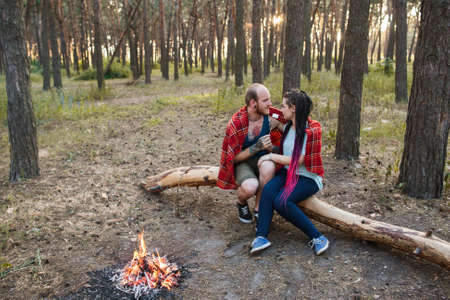 Couple love nature picnic bonfire forest concept. Happy together. Travel lifestyle. Stock Photo
