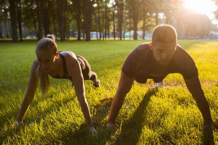 family outdoor sport together workout background concept. pair training. sportsman spouses lifestyle. Foto de archivo