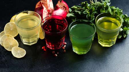 assortment of Georgian nonalcoholic drinks. Pomegrante juice, lemonade, tarkhun and mint refreshing beverages. Healthy lifestyle Stock Photo