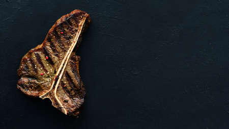 american pork chop steak on dark background. Barbecued and seasoned delicious quality meat dish. Stock fotó