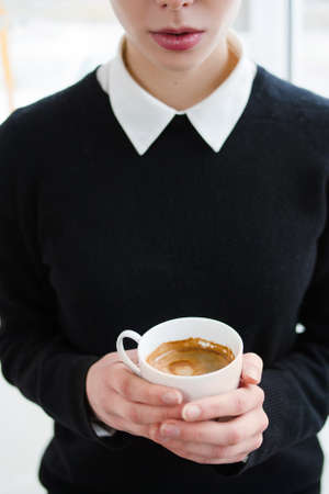 energy drink. coffee addiction. modern lifestyle. woman holding a cup of hot invigorating beverage