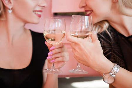 Bridal shower. Congratulation and celebration. Smiling girls clanging glasses.