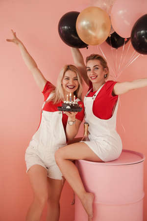 Birthday celebration fun. Party for two. Best friends with chocolate cake. Stock Photo