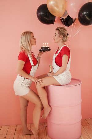 Romantic relationship anniversary. Happy lesbian couple. Two celebrating girlfriends.
