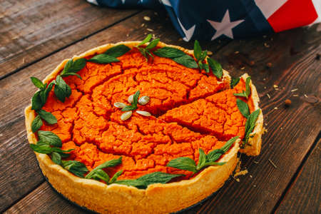 Autumn bakery. Traditional seasonal American food. Pumpkin pie for Thanksgiving holiday celebration.