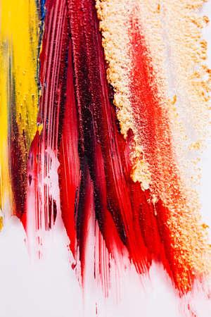 Art background. Makeup studio. Colorful lipstick strokes on white.