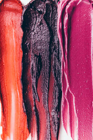 Makeup background. Beauty art fashion. Smeared textured lipstick samples.