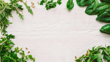 Healthy eating. Natural seasoning flavoring. Fresh green aromatic herbs on white wooden background.