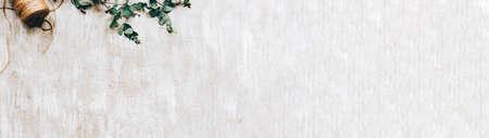 Floral background. Craft arrangement. Laurel decor twine cord on beige textured surface.