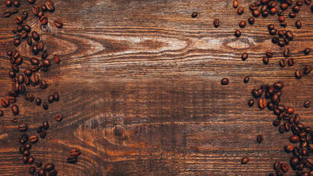 Rustic background. Coffee shop. Roasted beans on brown wooden surface. Zdjęcie Seryjne