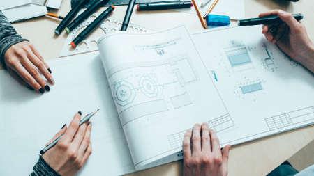 Interior design. Architect teamwork. Creative engineers working on project with scheme.