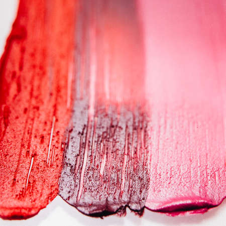 Smeared lipstick. Beauty art business. Textured strokes samples. Decorative background. Zdjęcie Seryjne