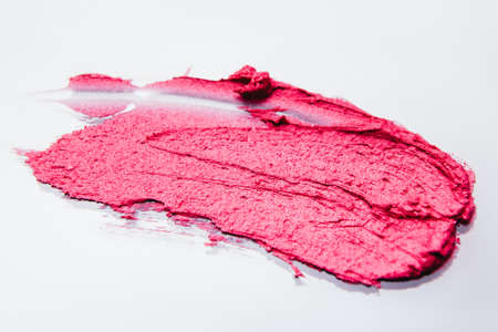 Cosmetics catalogue. Color palette sample. Pink lipstick stroke on white background.