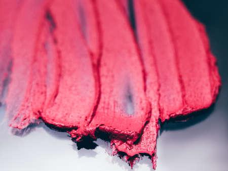 Smudged lipstick. Beauty salon catalogue. Crimson red strokes. Decorative background.