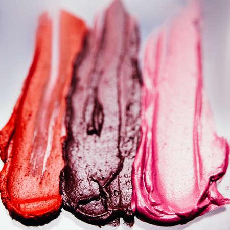 Lipstick swatch. Makeup artistry. Dark textured strokes. Creative background. Zdjęcie Seryjne