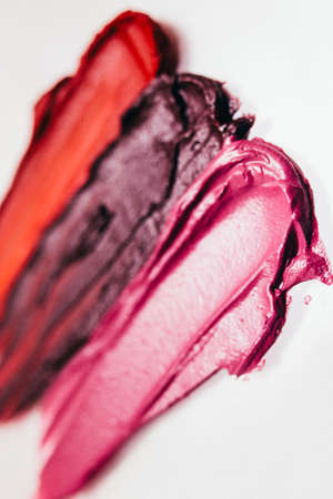 Lipstick palette. Beauty business art. Dark textured strokes. Creative background.