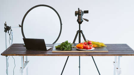 Photo studio. Professional object shooting. Camera softbox laptop food ingredients on table.