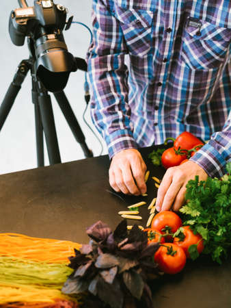Food photography. Creative occupation. Male stylist preparing vegetables for shooting.