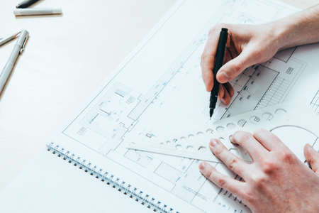 Architect career. Creative occupation. Male engineer drawing working project.
