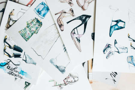 Designer workplace. Fashion sketching. Colorful women clothing footwear drawing collection. Zdjęcie Seryjne