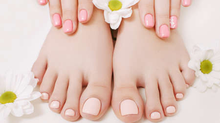 Nail therapy. Natural treatment. Manicure pedicure. Woman hands feet. Pastel color polish.