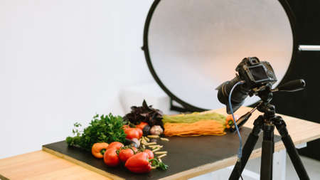 Food photography. Object shooting. Camera on tripod softbox organic vegetables on table. Zdjęcie Seryjne - 131259174