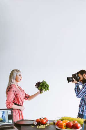 Professional food photography. Studio shooting. Woman with fresh herbs posing on white background. Stock Photo