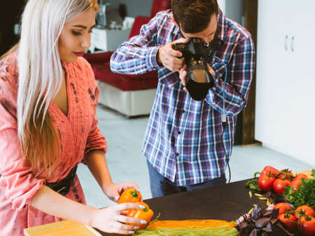 Food photography. Restaurant advertising. Creative team shooting vegetables pasta at studio.