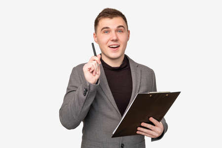 Business idea. Successful solution. Inspired man with clipboard isolated on white background.