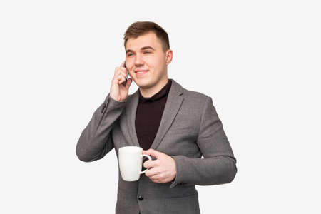 Business man lifestyle. Professional communication. Cheerful manager having phone call coffee isolated on white.