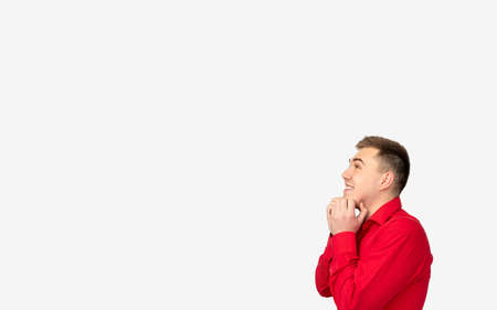 Commercial background. Logo text. Happy man in red shirt isolated on white empty space.