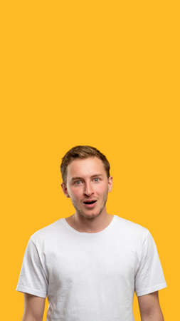 Omg portrait. Promotional background. Surprised man with open mouth isolated on orange copy space.