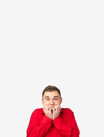 Commercial background. Ad message. Excited man in red shirt isolated on white copy space. Reklamní fotografie