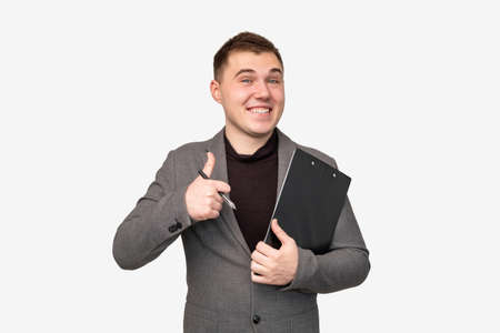 Business idea. Professional success. Cheerful man in suit showing thumb up isolated on white background.