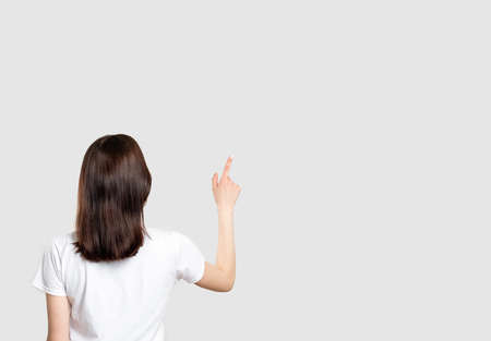 Commercial background. Ad message. Woman isolated pointing up at neutral copy space.