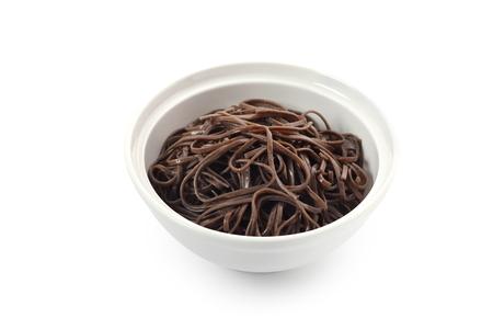 Buckwheat noodles on white background