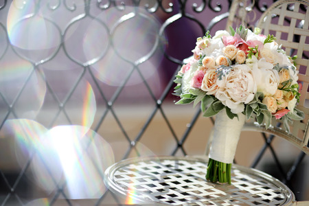 beautiful wedding bouquet of peony roses in the sunlight, flowers