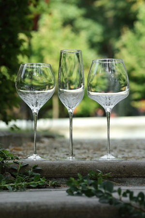 glass goblets standing on the steps outside in sunny weather vintage Stok Fotoğraf