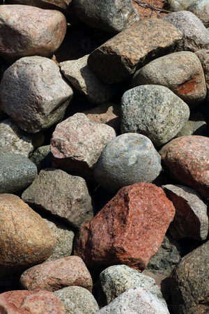 Lots of stones, big and small, lying on the floor makes for a beautiful stones background which can be used for wallpaper or other needed content.