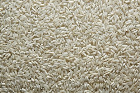 background of rice. Rice texture. Rice grains closeup. Top view