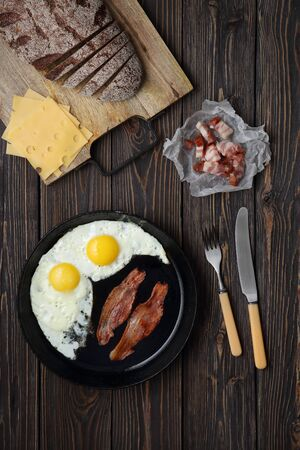 Bacon and eggs on wooden brown background. bread, cheese Stok Fotoğraf